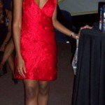 Cessane in red silk dress