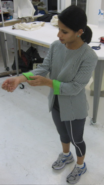 Anjali teases you with her chartreuse charmeuse at Tchad LLC - sewing classes in Chicago.