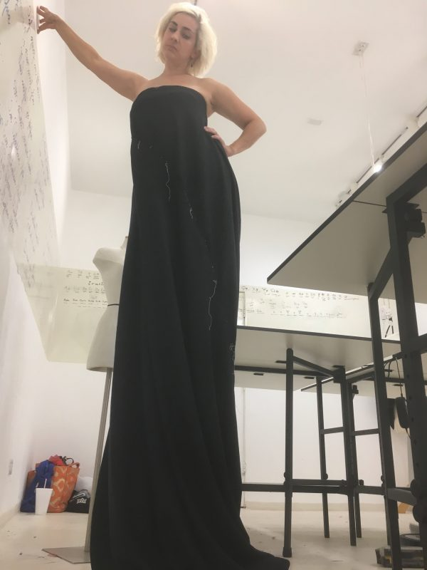 Testing the fit of strapless silk with Halston construction at Tchad workrooms
