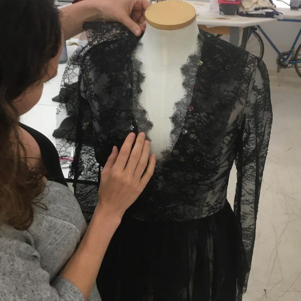 Edging a too-open neckline with scallops from lace... at Tchad workrooms