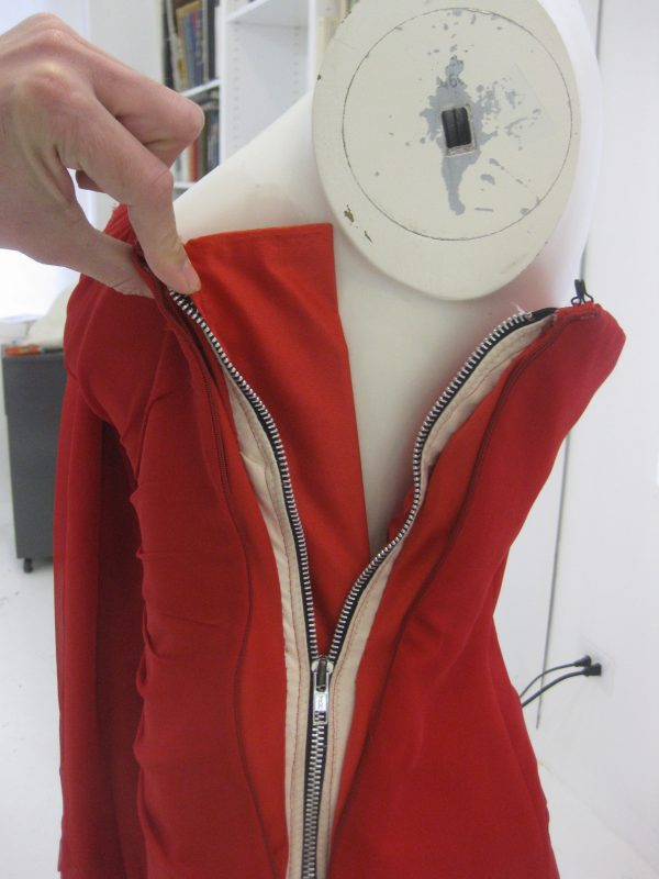 Even with the inner corset zipper more than halfway down the dress doesn't Fall or fail because of the structure through the bust and the fit through the waist. Properly fitting garments are stable even when they are exposing or failing.