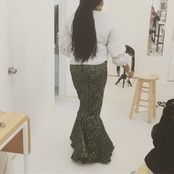 Ada models her finished skirt at the Tchad Workrooms!