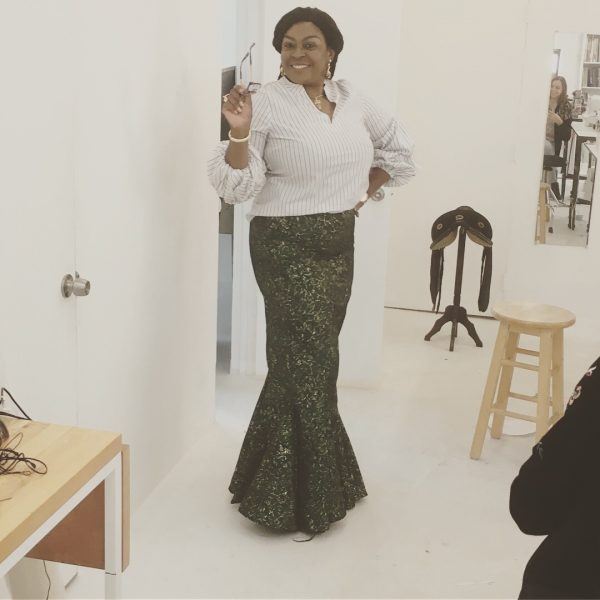 Ada models her finished skirt at the Tchad Workrooms