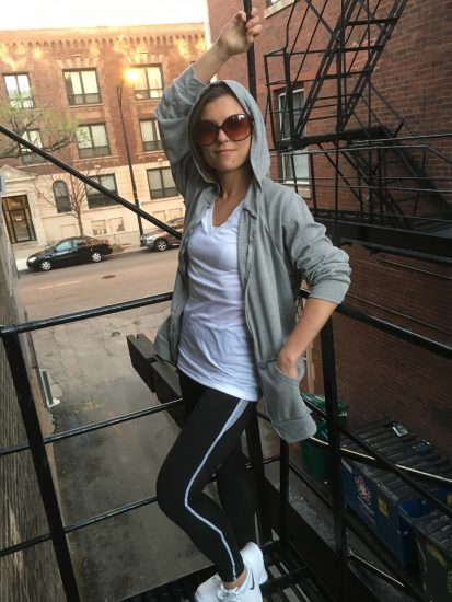 Jae on the fire escape at Tchad workroom enjoying her first hoodie.
