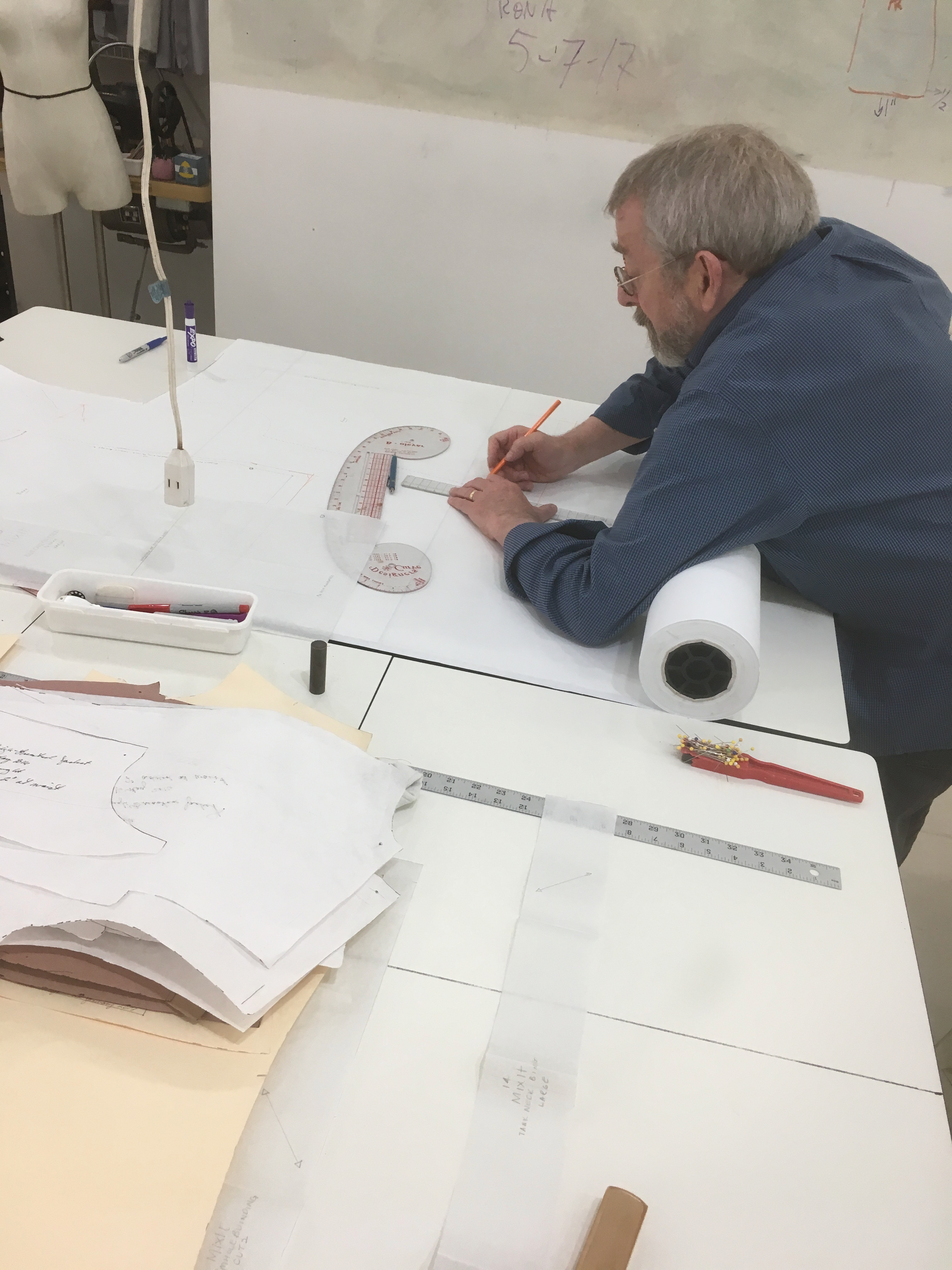 mark alters a draft at the tchad sewing workroom studio in chicago