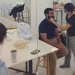 ankit getting eyebrows threaded at tchad workrooms sewing classes in chicago