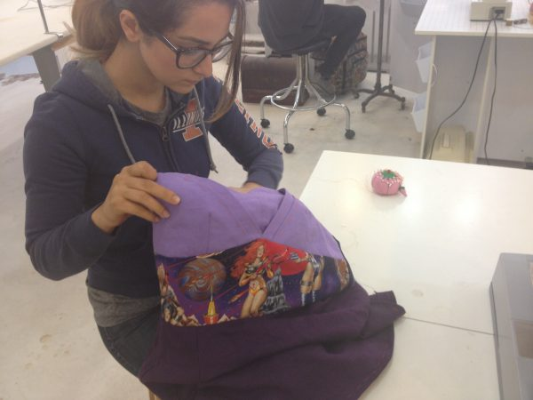 Maddie works out the details on McCall's #6830 in purple linen and Barbarella print cotton