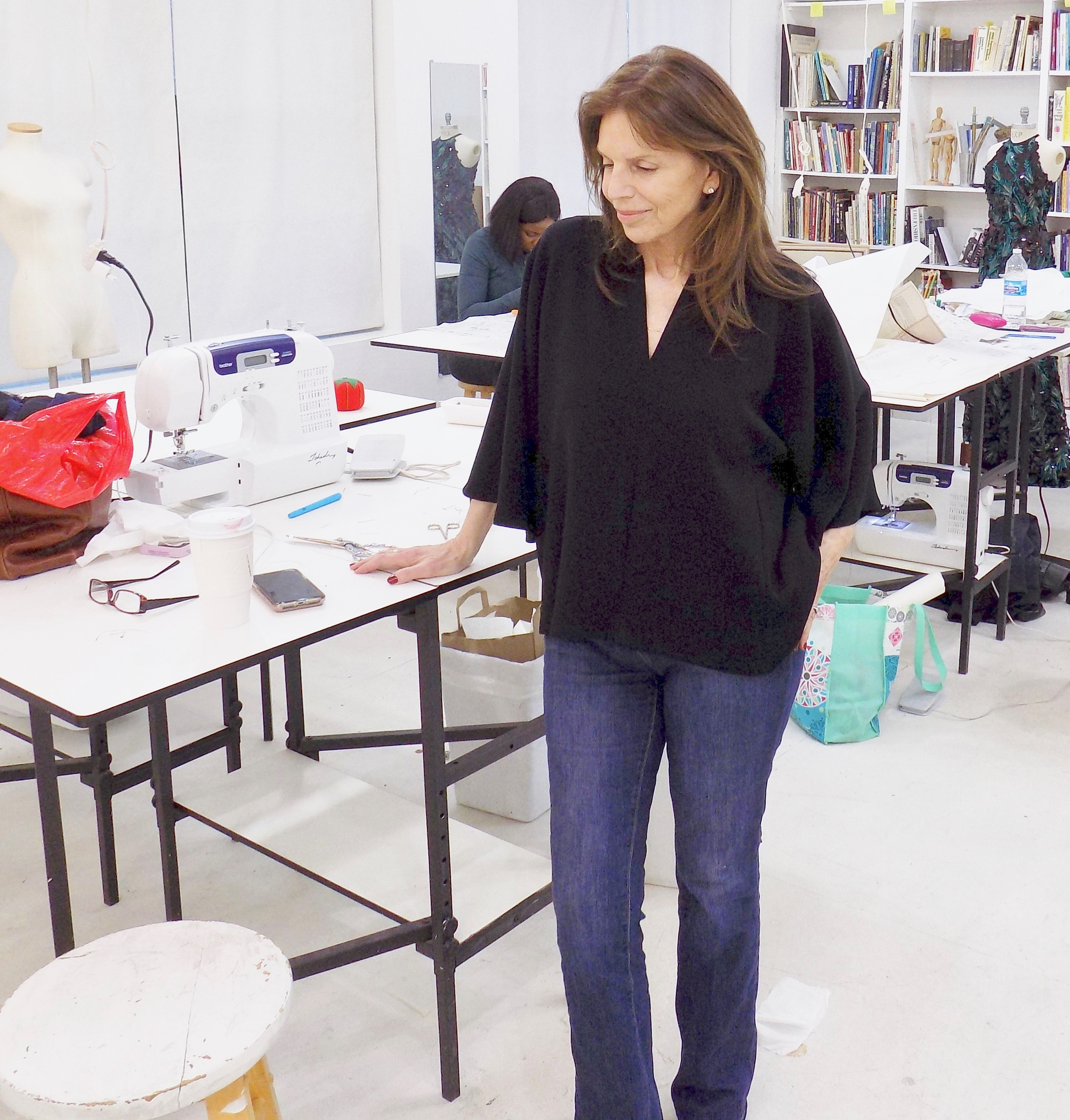 Peggy Asherman modeling her adapted Helmut Lang kimono cut blouse in black crepe at the Tchad workroom sewing studio in Chicago