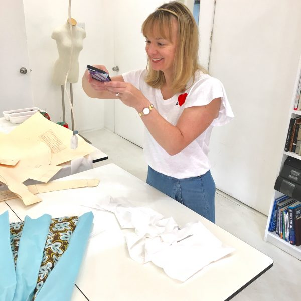 Erin Benoit takes a picture of her first project to post to instagram at Tchad workroom sewing studio in Chicago