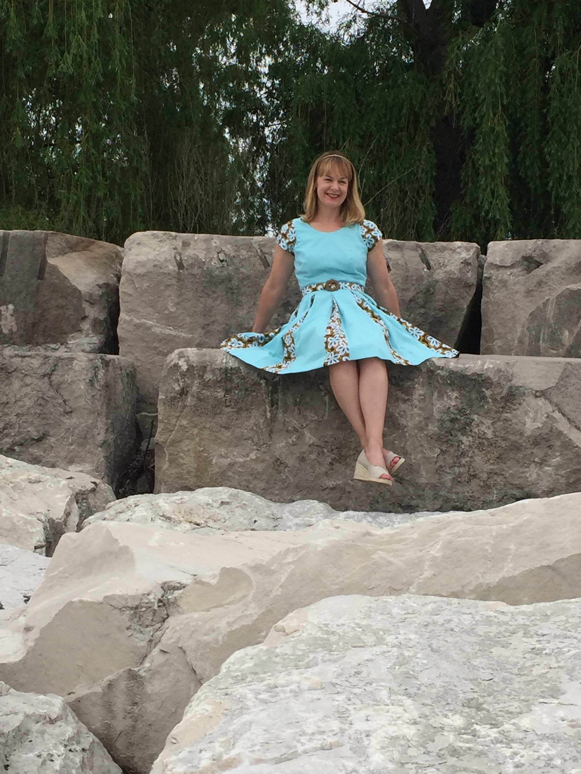 Erin Benoit sits on the breakers at Montrose Harbor in Chicago in her first project at Tchad Sewing Classes in Chicago