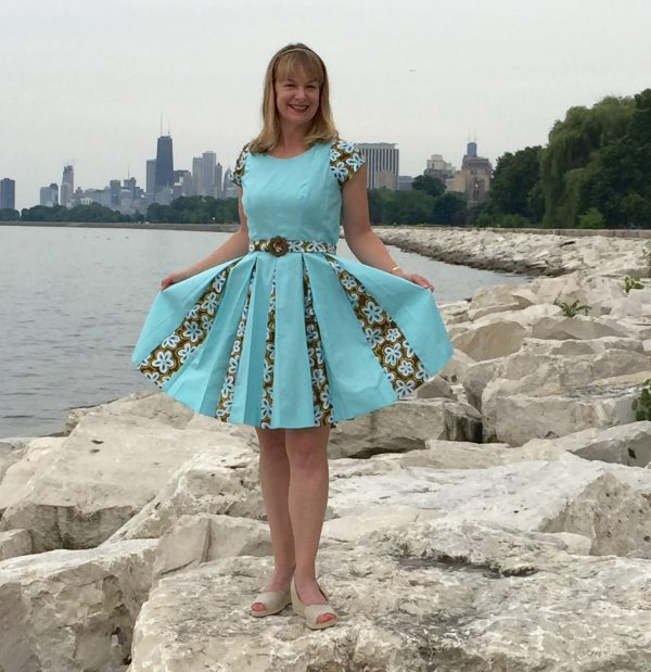 Erin Benoit poses on the breakers at Montrose Harbor in Chicago in her first project at Tchad Sewing Classes in Chicago