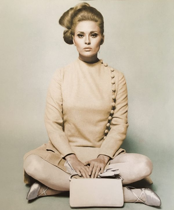 Faye Dunway sits in cashmere long sleeved dress as featured in Sew Iconic by Liz Gregory at the Tchad chicago sewing studio workroom library.