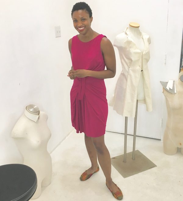 Omoleye models her version of the Kielo Wrap dress in fuchsia knit by Named Patterns at the Tchad workroom sewing studio in Chicago