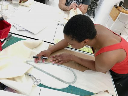 Sewing classes in Chicago: Omoleye alters her pattern at the Tchad workroom in Chicago.