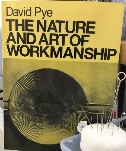 A photograph of David Pye's seminal book The Nature and Art of Workmanship photographed at the Tchad Workroom library in Chicago that hosts sewing classes in Chicago